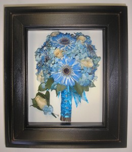Dried bouquet.  Notice the blue flowers look as blue as they did on her wedding day.  Beautiful!