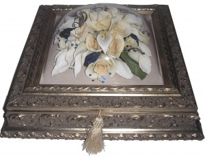 The brides bouquet preserved in a beautiful ornate jewelry box